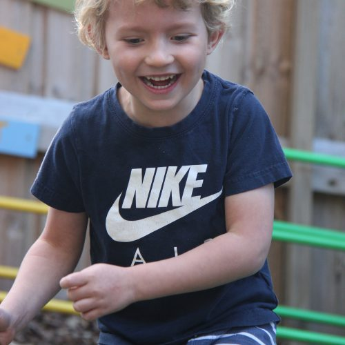 Little boy smiling during play activity