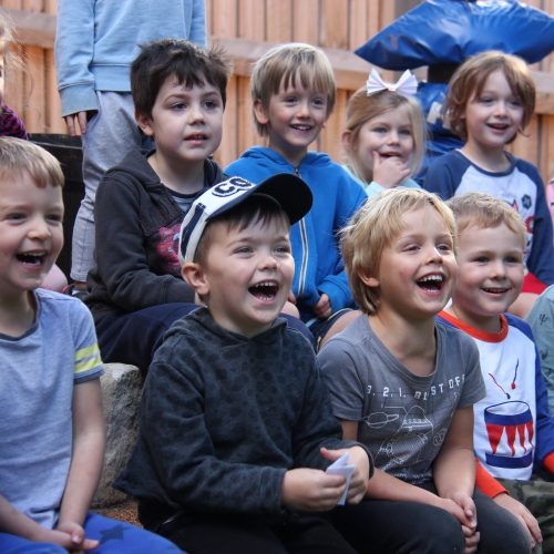 Children in audience laughing