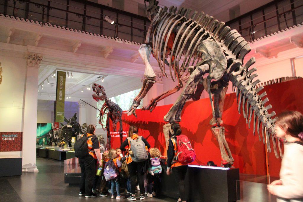 Children with dinosaur